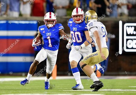 Stock Picture of Southern Methodist Mustangs wide receiver CJ Sanders (1) waits for block from Southern Methodist Mustangs running back Tyler Lavine (30) during special teams during an NCAA Football game between the Tulsa Golden Hurricanes and SMU Mustangs at the Gerald J. Ford Stadium in Dallas, Texas, Oct. 5th, 2019