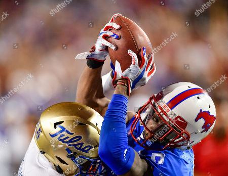 Southern Methodist Mustangs wide receiver James Proche (3) catches the game winning touchdown during overtime against Tulsa Golden Hurricane safety Brandon Johnson (8) during an NCAA Football game between the Tulsa Golden Hurricanes and SMU Mustangs at the Gerald J. Ford Stadium in Dallas, Texas, Oct. 5th, 2019