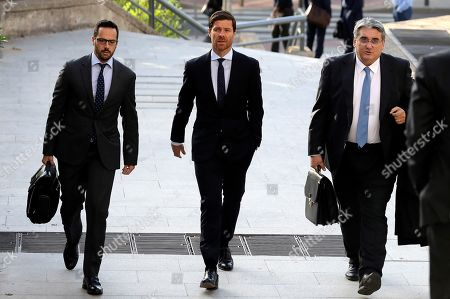 Former professional soccer player Xabi Alonso (C), next to his lawyers, arrives to Audiencia Nacional court to attend his trial for several alleged tax fraud charges, in Madrid, Spain, 09 October 2019. Alonso and two other defendants are accused of committing fraud in tax years 2010, 2011 and 2012.