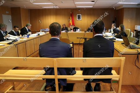 Former professional soccer player Xabi Alonso (R) sits on the dock at Audiencia Nacional during his trial for several alleged tax fraud charges in Madrid, Spain, 09 October 2019. Alonso and two other defendants are accused of committing fraud in tax years 2010, 2011 and 2012.