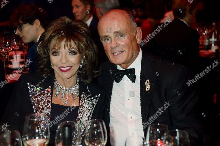 Dame Joan Collins and guest