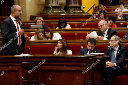 Catalan regional Home Minister Miquel Buch (L) delivers a speech near Catalan regional President Joaquim Torra (R) during the weekly Catalan regional government's question time session at regional Parliament, in Barcelona, northeastern Spain, 09 October 2019.