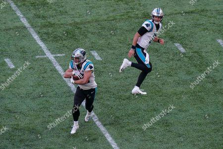 Carolina Panthers quarterback Kyle Allen  (7) hands off to running back Christian McCaffrey  (22)