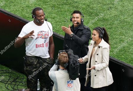 NFL  0n the Field Game Day presenters Jason Bell (centre) and  Sam Quek with Former Tampa Bay Buccaneers player Simeon Rice
