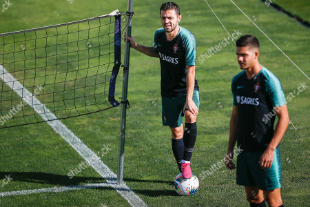 Portugal's players Bernardo Silva (L) and Andre Silva (R) during a training session of the Portuguese National Team preparation for the upcoming UEFA Euro 2020 qualifier matches against Luxemburg and Ukraine, at Cidade do Futebol in Oeiras, outskirts of Lisbon, Portugal, 09 October 2019.