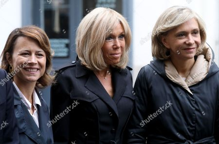 French First Lady Brigitte Macron (C), Mayor of Paris' 9th district, Delphine Burkli (L), and President of French Ile-de-France region Valerie Pecresse (R) wait to welcome Princess Mary of Denmark (unseen) during a visit at the high school Lamartine in Paris, France, 09 October 2019.