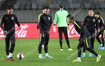 South Korea's captain Heung-Min Son (2-L) smiles during a training session at Hwaseong Sports Complex Main Stadium in Hwaseong, south of Seoul, 09 October 2019. Sri Lanka will face South Korea in their Group H second round soccer match of the Asian qualifying for the 2022 FIFA World Cup on 10 October 2019.