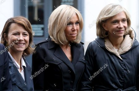 French first lady Brigitte Macron, center, Mayor of Paris' 9th district, Delphine Burkli, left, and President of French Ile-de-France region Valerie Pecresse wait for Crown Princess Mary of Denmark, at the high school Lamartine, in Paris