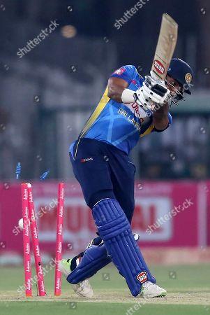 Sri Lankan batsman Danushka Gunathilaka is clean bowled by Pakistani pacer Muhammad Amir in the final of Twenty20 between Pakistan and Sri Lanka at the Gaddafi Stadium in Lahore, Pakistan