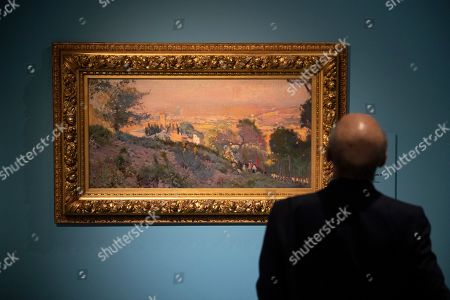 Stock Picture of A visitor looks at the painting 'Sant Genis dels Agudells' by Spanish artist Joaquim Mir during a press preview of the exhibition 'Impressionism and Spanish Art' at the Museum of Russian Impressionism in Moscow, Russia, 09 October 2019. Spanish art from the 19th-20th centuries is on show in the first such large-scale exhibit in Russia from 10 October 2019 to 26 January 2020, featuring works of 18 Spanish artists from museums and private collections in Spain, as well as two canvases from the collection of the Pushkin Museum in Moscow.