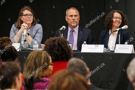 """Stock Image of Democratic candidate for the 88th district of the Virginia House of Delegates, Jessica """"Jess"""" Foster, left, listens along with, Democratic candidate for the 4th district for the Virginia Senate, Raymond """"Stan"""" Scott, center, and Democratic candidate for the 17th district for the Virginia Senate, Amy Laufer, during the Spotsylvania branch of the NAACP candidates forum in Fredericksburg, Va., . Foster faces"""