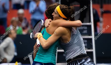 Julia Goerges and Andrea Petkovic of Germany at the net after their second-round match