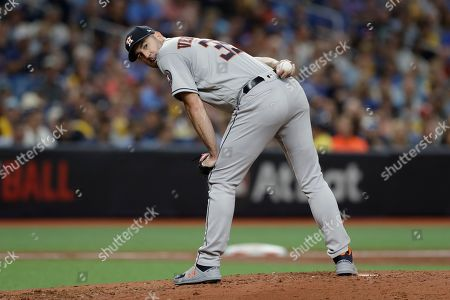 Houston Astros' Justin Verlander checks a Tampa Bay Rays runner during Game 4 of a baseball American League Division Series, in St. Petersburg, Fla