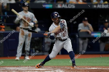 Houston Astros' Jose Altuve (27) bats against the Tampa Bay Rays during Game 4 of a baseball American League Division Series, in St. Petersburg, Fla