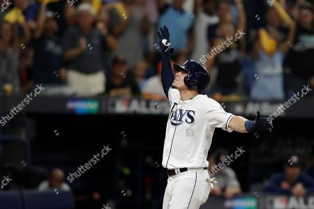 Tampa Bay Rays' Willy Adames celebrates his home run off Houston Astros starting pitcher Justin Verlander during Game 4 of a baseball American League Division Series, in St. Petersburg, Fla