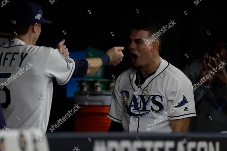 Tampa Bay Rays' Willy Adames, right, celebrates his home run off Houston Astros starting pitcher Justin Verlander during Game 4 of a baseball American League Division Series, in St. Petersburg, Fla