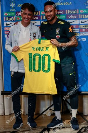 Former Brazil soccer player Bebeto (L) presents Neymar (R) with a commemorative jersey marking his 100th appearance for the national team during a press conference in Singapore, 09 October 2019. Brazil will play two international soccer matches against Senegal and Nigeria on 10 and 13 October respectively at the National Stadium in Singapore.