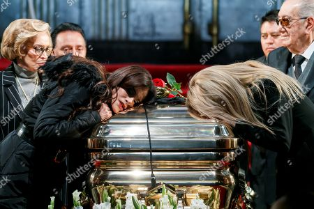 Lucia Mendez (L) and Dulce (R) touch the coffin with part of the singer Jose Jose's ashes during a tribute at the Palacio de Bellas Artes, in Mexico City, Mexico, 09 October 2019. Mexico City-born singer Jose Jose died on 28 September at the age of 71 in South Florida, and was cremated in Miami. A tribute held at the Palace of Fine of Mexico to the late singer Jose Jose began in the middle of a crowd of fans. Half of the ashes were left in Miami, USA, with the singer's widow, Cuban Sara Salazar, and their daughter, Sarita Sosa Salazar.