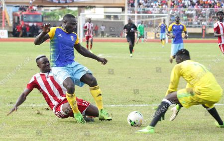 Liberia striker, Sam Johnson (L) with opponent  in action during 2021 Africa Cup of Nations qualification preliminary round match  between Liberia and Chad at the Antoinette Tubman Stadium in Paynesville, outside Monrovia, Liberia, 9 October 2019. Liberia and Chad are among eight teams paired based on their  FIFA World ranking for qualification matches. The four winners will move to the group stage to join 44 teams which entered directly.