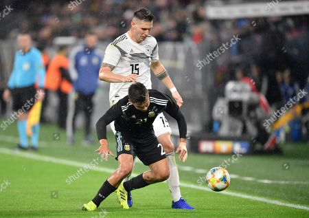 Germany's Niklas Suele, top, challenges for the ball with Argentina's Paulo Dybala during the international friendly soccer match between Germany and Argentina at the Signal Iduna Park stadium in Dortmund, Germany