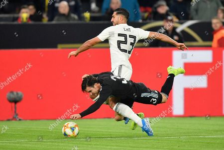 Germany's Emre Can, top, challenges for the ball with Argentina's Nicolas Tagliafico during the international friendly soccer match between Germany and Argentina at the Signal Iduna Park stadium in Dortmund, Germany