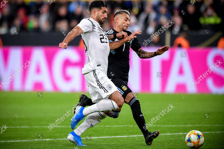 Germany's Emre Can (L) in action against Argentina's Roberto Pereyra (R) during the international friendly soccer match between Germany and Argentina in Dortmund, Germany, 09 October 2019.