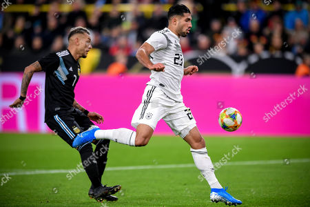 Germany's Emre Can (R) in action against Argentina's Roberto Pereyra (L) during the international friendly soccer match between Germany and Argentina in Dortmund, Germany, 09 October 2019.