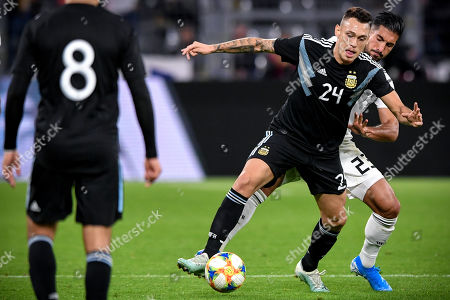 Argentina?s Lucas Ocampos (C) in action against Germany's Emre Can (R) during the international friendly soccer match between Germany and Argentina in Dortmund, Germany, 09 October 2019.