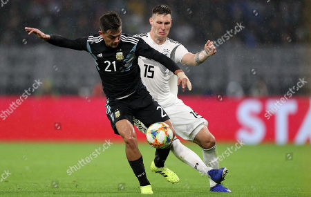 Argentina's Paulo Dybala (R) in action with Germany's Niklas Suele (L) during the international friendly soccer match between Germany and Argentina in Dortmund, Germany, 09 October 2019.