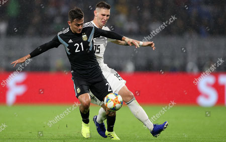 Stock Picture of Argentina's Paulo Dybala (R) in action with Germany's Niklas Suele (L) during the international friendly soccer match between Germany and Argentina in Dortmund, Germany, 09 October 2019.