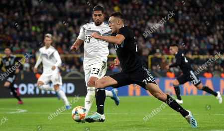 Stock Photo of Germany's Emre Can in action with Argentina's Lucas Ocampos during the international friendly soccer match between Germany and Argentina in Dortmund, Germany, 09 October 2019.