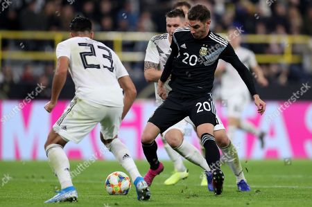 Stock Picture of Germany's Emre Can in action with Argentina's Lucas Alario during the international friendly soccer match between Germany and Argentina in Dortmund, Germany, 09 October 2019.