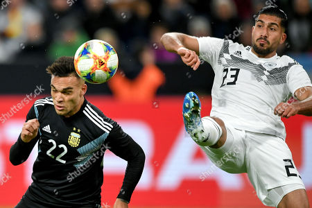 Argentina's Lautaro Martinez (L) in action against Germany's Emre Can (R) during the international friendly soccer match between Germany and Argentina in Dortmund, Germany, 09 October 2019.