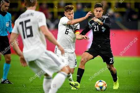 Stock Photo of Argentina's Paulo Dybala (R) in action against Germany's Joshua Kimmich (C) during the international friendly soccer match between Germany and Argentina in Dortmund, Germany, 09 October 2019.