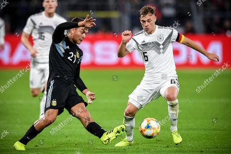 Stock Image of Argentina's Paulo Dybala (L) in action against Germany's Joshua Kimmich (R) during the international friendly soccer match between Germany and Argentina in Dortmund, Germany, 09 October 2019.