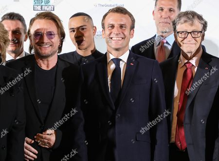 """Irish rock band U2 singer Bono (2-L), French fashion designer Olivier Rousteing (3-L), French President Emmanuel Macron (4-L) and US Microsoft founder, Co-Chairman of the Bill & Melinda Gates Foundation, Bill Gates (R), pose for a family picture at Lyon's city hall, Lyon, France, 09 October 2019, ahead of the two-day conference of Global Fund to Fight HIV, Tuberculosis and Malaria. Macron is to chair the final day of the meeting on 10 October 2019, and meet African heads of state. The fund has asked for $14 billion, an amount it says would help save 16 million lives, avert """"234 million infections"""" and place the world back on track to meet the UN objective of ending the epidemics of HIV/AIDS, tuberculosis and malaria within 10 years."""