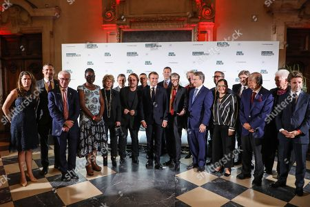 """Family picture with Irish rock band U2 singer Bono (C-L), French President Emmanuel Macron (C-M) and US Microsoft founder, Co-Chairman of the Bill & Melinda Gates Foundation, Bill Gates (C-R) at Lyon's city hall, Lyon, France, 09 October 2019, ahead of the two-day conference of Global Fund to Fight HIV, Tuberculosis and Malaria. Macron is to chair the final day of the meeting on 10 October 2019, and meet African heads of state. The fund has asked for $14 billion, an amount it says would help save 16 million lives, avert """"234 million infections"""" and place the world back on track to meet the UN objective of ending the epidemics of HIV/AIDS, tuberculosis and malaria within 10 years."""