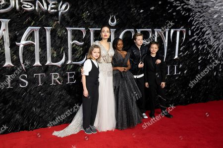 Angelina Jolie, Vivienne Jolie-Pitt, from left, Zahara Jolie-Pitt, Shiloh Jolie-Pitt, Knox Leon Jolie-Pitt. Actress Angelina Jolie, second Left, and her children Vivienne Jolie-Pitt, from left, Zahara Jolie-Pitt, Shiloh Jolie-Pitt and Knox Leon Jolie-Pitt pose for photographers on arrival at the Premiere of the film 'Maleficent Mistress of Evil' in central London on