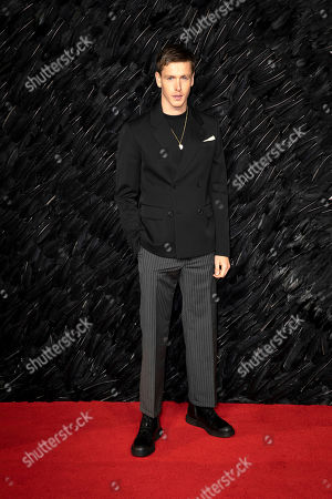 Harris Dickinson poses for photographers on arrival at the Premiere of the film 'Maleficent Mistress of Evil' in central London on