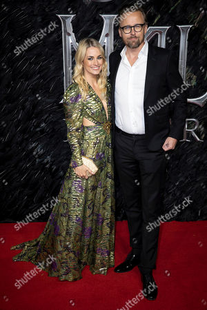 Stock Image of Joachim Ronning and partner Kristin Ronning pose for photographers on arrival at the European Premiere of the film 'Maleficent Mistress of Evil' in central London on