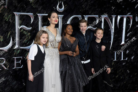 Angelina Jolie, 2nd Left, and her children Vivienne Jolie-Pitt, Zahara Jolie-Pitt, Shiloh Jolie-Pitt and Knox Leon Jolie-Pitt, pose for photographers on arrival at the Premiere of the film 'Maleficent Mistress of Evil' in central London on