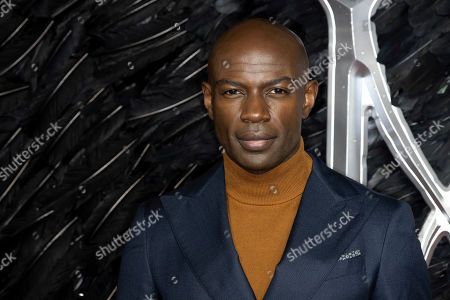 David Gyasi poses for photographers on arrival at the Premiere of the film 'Maleficent Mistress of Evil' in central London on