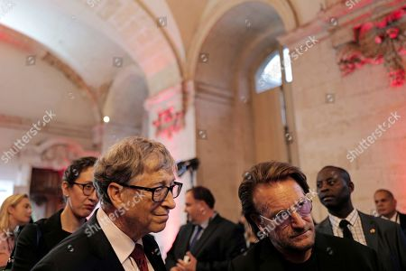 US Microsoft founder, Co-Chairman of the Bill & Melinda Gates Foundation, Bill Gates (L) and Irish rock band U2 singer Bono arrive at the City Hall of Lyon, France, 09 October 2019, ahead of the two-day conference of Global Fund to Fight HIV, Tuberculosis and Malaria. President Macron is to chair the final day of the meeting on 10 October 2019, and meet African heads of state. The fund has asked for 14 billion US dollars, an amount it says would help save 16 million lives, avert '234 million infections' and place the world back on track to meet the UN objective of ending the epidemics of HIV/AIDS, tuberculosis and malaria within 10 years.