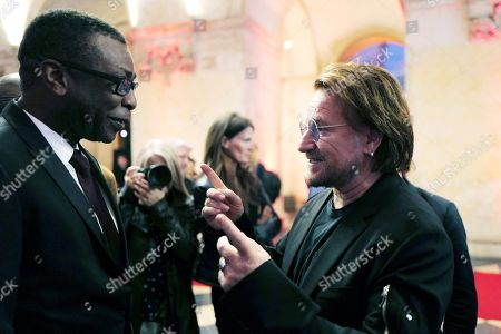 Stock Image of Senegalese singer Youssou N'dour (L) speaks with Irish rock band U2 singer Bono (R) as they arrive at the City Hall of Lyon, France, 09 October 2019, ahead of the two-day conference of Global Fund to Fight HIV, Tuberculosis and Malaria. President Macron is to chair the final day of the meeting on 10 October 2019, and meet African heads of state. The fund has asked for 14 billion US dollars, an amount it says would help save 16 million lives, avert '234 million infections' and place the world back on track to meet the UN objective of ending the epidemics of HIV/AIDS, tuberculosis and malaria within 10 years.