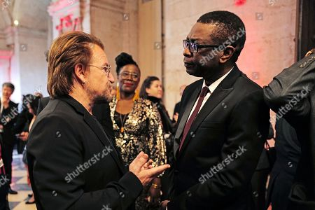Stock Picture of Senegalese singer Youssou N'dour (R) speaks with Irish rock band U2 singer Bono (L) as they arrive at the City Hall of Lyon, France, 09 October 2019, ahead of the two-day conference of Global Fund to Fight HIV, Tuberculosis and Malaria. President Macron is to chair the final day of the meeting on 10 October 2019, and meet African heads of state. The fund has asked for 14 billion US dollars, an amount it says would help save 16 million lives, avert '234 million infections' and place the world back on track to meet the UN objective of ending the epidemics of HIV/AIDS, tuberculosis and malaria within 10 years.