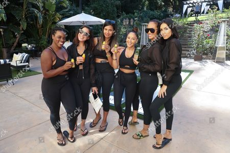 Adrienne Houghton, Evelyn Lozada and guests