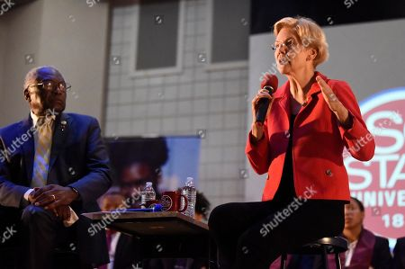 U.S. House Majority Whip Jim Clyburn, left, watches as U.S. Sen. Elizabeth Warren, right, speaks at a town hall about their joint legislative effort on student debt loan relief, at South Carolina State University in Orangeburg, S.C
