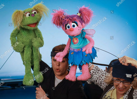 """This photo shows puppeteers Haley Jenkins, left, and Leslie Carrara-Rudolph performing with their """"Sesame Street"""" muppets Karli and Abby Cadabby, respectively, for segments about parental addiction in New York. Sesame Workshop is addressing the issue of addiction. Data shows 5.7 million children under 11 live in households with a parent with substance use disorder"""