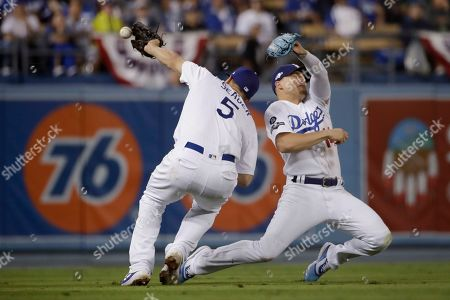 Stock Image of Los Angeles Dodgers shortstop Corey Seager, left, and second baseman Enrique Hernandez can't catch a foul ball hit by Washington Nationals' Juan Soto during the fourth inning in Game 5 of a baseball National League Division Series, in Los Angeles