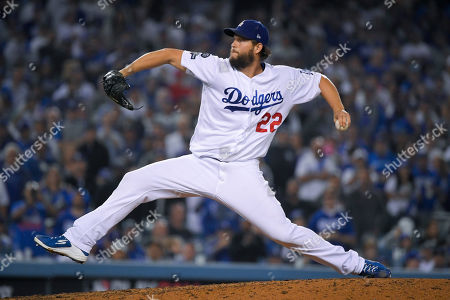 Los Angeles Dodgers pitcher Clayton Kershaw throws to a Washington Nationals batter during the seventh inning in Game 5 of a baseball National League Division Series, in Los Angeles